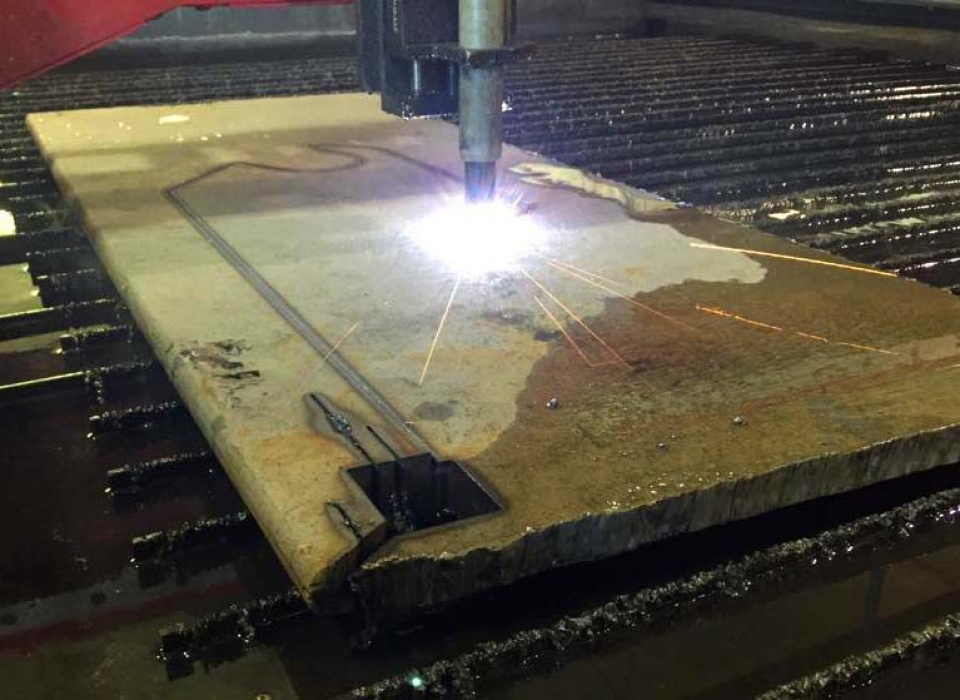 Thick steel being cut to shape in CNC Plasma table