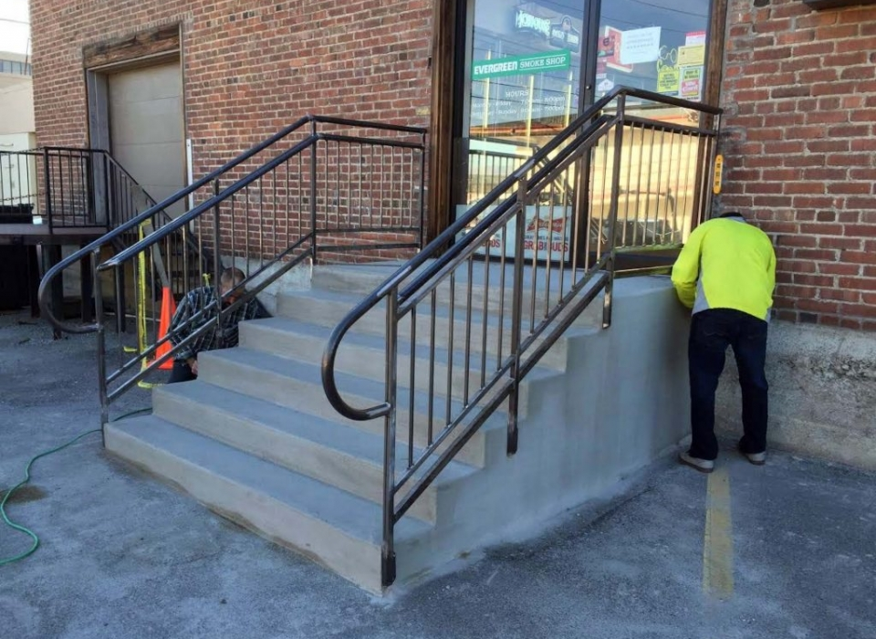 Hand railings being installed